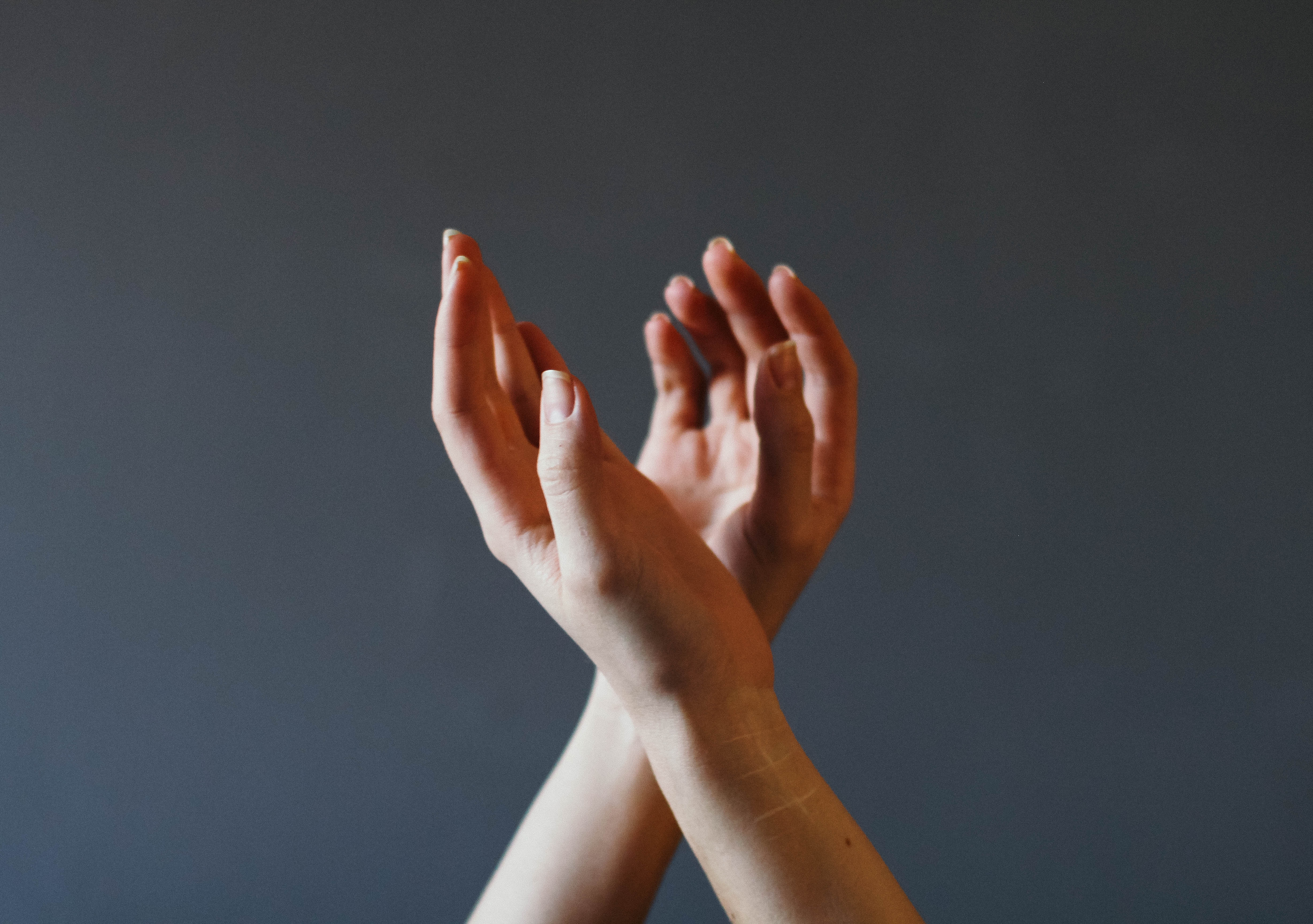 hands on a gray background